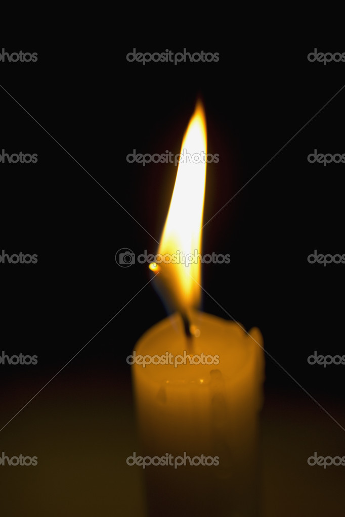 Old burning candle of background gradient  Stock Photo #8404229
