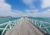 Wooden long bridge reach out the sea — Stock Photo