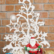 Stock Photo: White see through Christmas tree with Santand balls