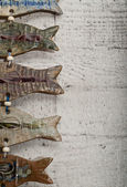 Half fish body pottery on wooden board — Stock Photo