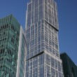Modern high-rise building of glass and concrete. — Stock Photo #8427858