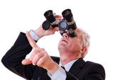Business man looking upwards through binoculars — Fotografia Stock