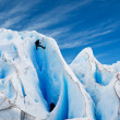 Stock Photo: Two men climbing glacier in patagonia.