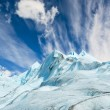 Climbers walk up on glacier in Patagonia. — Stock Photo