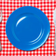 Blue dinner plate with fork and knife — Stock Photo