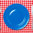 Blue dinner plate with fork and knife — Stock Photo #9161781