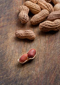 Peanuts on wood. — Stock Photo