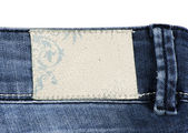 Blue denim jeans with blank label isolated on white — Stock Photo