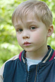 Portrait of a boy of five years. On a walk in the park. — Stock Photo