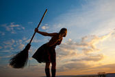 Pretty witch with broom — Stock Photo