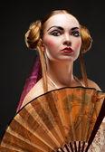 Beautiful young geisha girl — Stock Photo