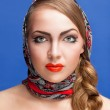 Young woman in a headscarf in the Russian style. — Stock Photo #9889379