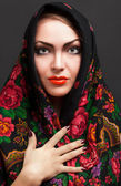 Young woman in a headscarf in the Russian style. — Stock Photo