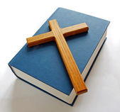 Wooden cross on bible — Stock Photo