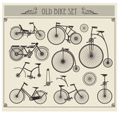 Bicicletas antiguas — Vector de stock