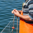 Stock Photo: Fishermsewing nets