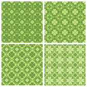 Cute clovers patterns — Stock Vector