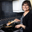 Stock Photo: An indian lady cooking