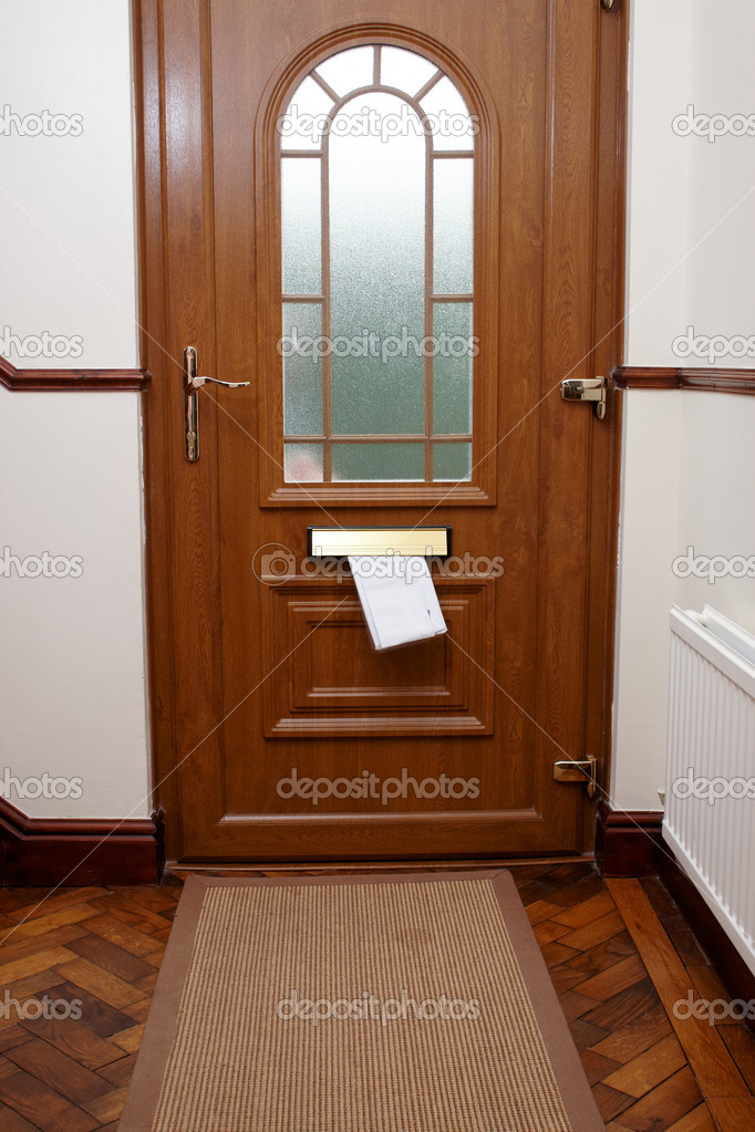 Letters being pushed through a letter box — Stock Photo #8513686
