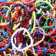 Foto de Stock  : Basket full of colourful beads