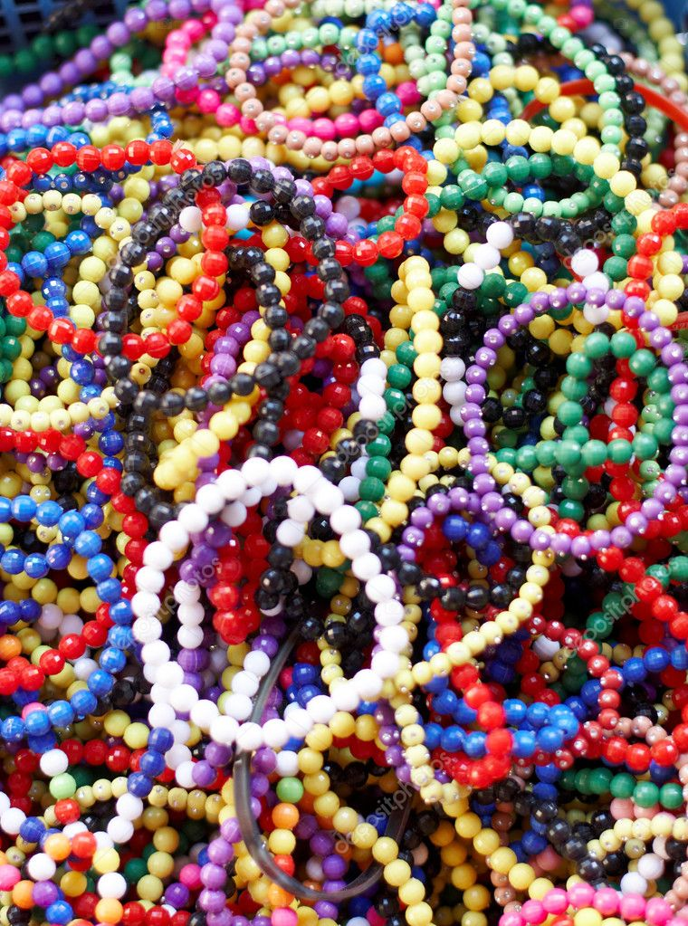 A basket full of colourful beaded bangles — Stock Photo #8596501