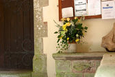 Cut flowers outside a church door — Stock Photo