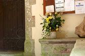 Cut flowers outside a church door — Stock Photo