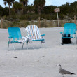 Stock Photo: Three empty deck chairs