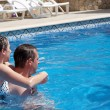 Stock Photo: Young couple in swimming pool