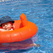 A baby in the swimming pool — Stock Photo