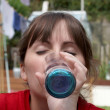 A young female drinking a glass of water — Foto Stock