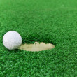 Golf ball near the hole — Stock Photo #10362761