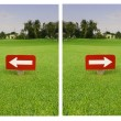 Stock Photo: White arrow in red label on green grass at golf club
