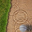 Golf ball drop in water bunker near green grass — Stock Photo #9273652
