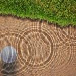 Golf ball drop in water bunker near green grass — Stock Photo #9273667