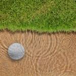 Golf ball drop in water bunker near green grass — Stock Photo #9273731