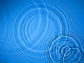 Blue circle water ripple background — Stock Photo