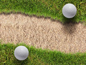 Two golf ball on green grass near sand bunker — Stock Photo