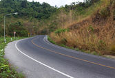 Country road and curves up the mountain — Stock Photo