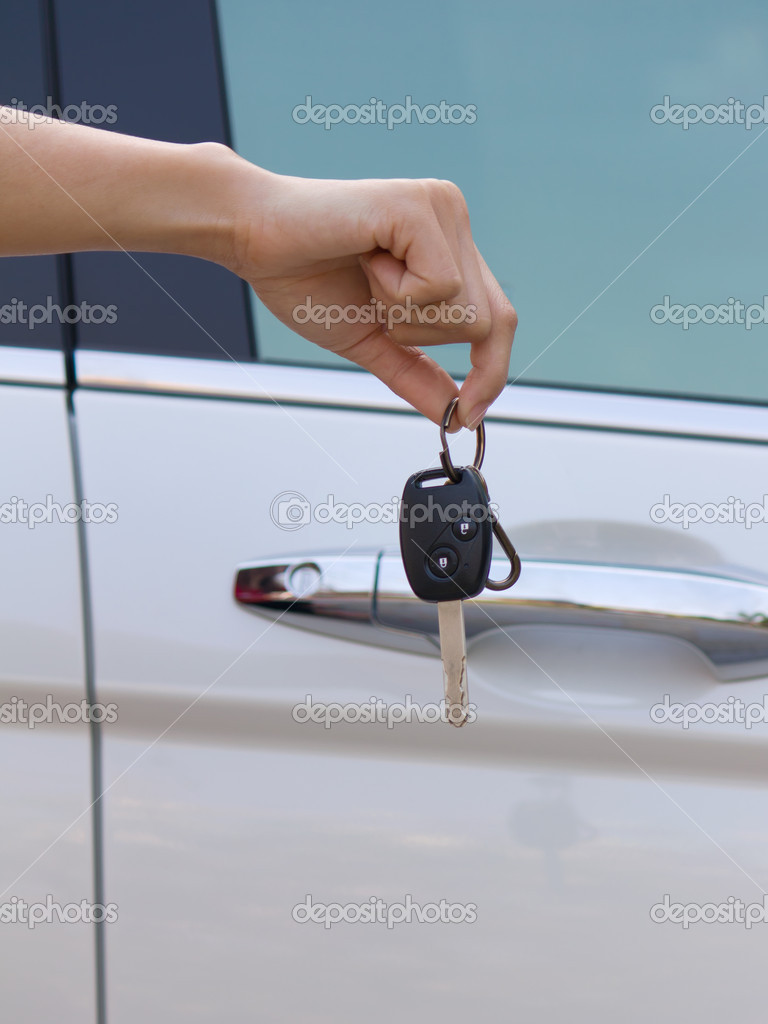 Black car key in hand  Stock Photo #9586399