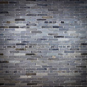 Old gray stone brick wall — Stock Photo