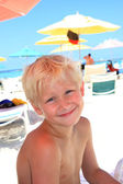 Seven year old blonde boy at the beach — Stock Photo