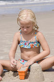 Girl Making Sand Castles at Beach — Stock Photo