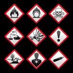 New safety symbols Hazard signs Black background — Stock Vector