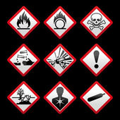 New safety symbols Hazard signs Black background — Stock Vector