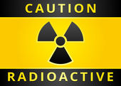 Label caution sign. Radiation Hazard symbol — Stock Vector