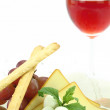 Appetizer with cheese, grissini and grapes — Stock Photo