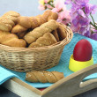Butter shortbread biscuits and Easter egg on the table — Stock fotografie