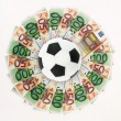 Football and money — Stock Photo