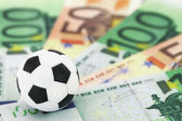 Football and money — Stock Photo